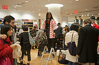 Customers shop at the grand opening of the Uniqlo store on West 34th street in New York on Friday, October 21, 2011.  The new store is Fast Retailing's third store in New York, opening just a week after its Fifth Avenue flagship store.  Fast Retailing plans on opening 200 to 300 stores worldwide until 2020 and currently has 1000 stores. (© Richard B. Levine)