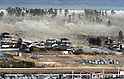 Houses Engulfed by a Massive Tsunami in Nattori, Miyagi Prefecture at 3.55pm following a large Earthquake on March 11th, 2011.