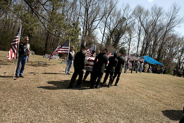 March 22, 2008. Greenvile NC..A funeral was held for Staff Sergeant Juantrea Bradley Sr., a member of the 7th Special Troops Battalion, 7th Sustainment Brigade, 10th Mountain Division who was killed on March 12, 2008 by indirect enemy fire near Tallil, Iraq. He is survived by a wife and 4 children.. The honor guard carries the casket of Ssgt. Bradley to the gravesite.