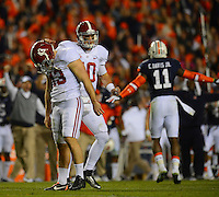 Photo by Gary Cosby Jr.     The Auburn Tigers pull off another last second miracle defeating top ranked Alabama 34-28.  Alabama place kicker Cade Foster drops his head as AJ McCarron gives him an encouraging pat on the helmet after he missed a field goal in the fourth quarter.
