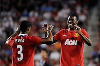 Danny Welbeck (19) of Manchester United celebrates scoring with Patrice Evra (3). Manchester United defeated the MLS All-Stars 4-0 during the MLS ALL-Star game at Red Bull Arena in Harrison, NJ, on July 27, 2011.