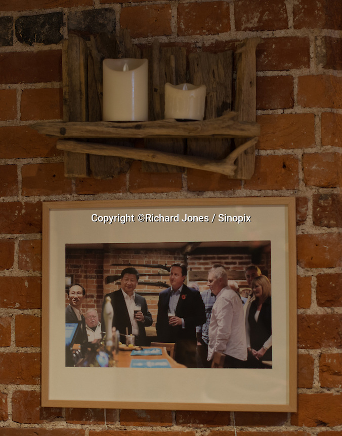 Pictures of David Cameroon and Le Jinxing during their meeting The Plough, on the wall at The Plough at Cadsden, Buckinghamshire October 2015. The group bought the pub after it was visited by Chinese Premiere Ji Jinping last year, and aim to develop  a chain of English-style pubs China.<br /> <br /> Photo by Richard Jones