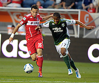 Chicago midfielder Marco Pappa (16) is pressured by Portland defender Jeremy Hall (17).  The Portland Timbers defeated the Chicago Fire 1-0 at Toyota Park in Bridgeview, IL on July 16, 2011.
