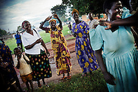In an Internally Displaced Persons (IDP) camp in Northern Uganda, nurses sing and dance to welcome visitors from an international NGO. .