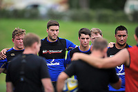 Matt Banahan of Bath Rugby looks on in a huddle. Bath Rugby training session on August 4, 2015 at Farleigh House in Bath, England. Photo by: Patrick Khachfe / Onside Images