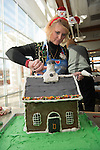 Heidi Miller helps to create the Patton College of Educations entry into this years gingerbread decoration competition. Photo by Ben Siegel