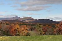 Mountains under fall foliage.