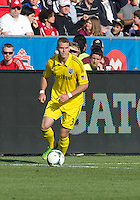 18 May 2013: Columbus Crew defender Josh Williams #3 in action during an MLS game between the Columbus Crew and Toronto FC at BMO Field in Toronto, Ontario Canada..The Columbus Crew won 1-0...