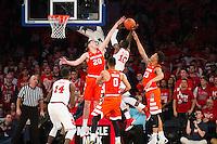 NEW YORK, NY - Sunday December 13, 2015: Tyler Lydon (#20) of Syracuse, left, blocks the shot of Felix Balamou (#10) of St. John's, right.  St. John's defeats Syracuse 84-72 during the NCAA men's basketball regular season at Madison Square Garden in New York City.