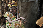 A woman in a camp in rebel-held territory in the eastern Congo. Families displaced by fighting between rebel Tutsi General Laurent Nkunda and the Congolese military took refuge in this camp they established in the shadow of a United Nations base in the village of Kiwanja. According to aid workers and human rights groups, rebel soldiers executed some 150 people here in a 24-hour period in early November. The killings took place half a mile from the UN base, yet the 120 UN peacekeepers, part of the largest UN peacekeeping contingent in the world, did not take any action to stop the violence. ..