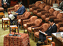 February 3, 2012, Tokyo, Japan - Japan's Prime Minister Yoshiho Noda, foreground, and Defense Minister Naoki Tanaka go through their reference papers before the start of a Diet lower house Budget Committee meeting in Tokyo on Friday, February 3, 2012. Both Noda and Tanaka were caught in a crossfire from the opposition camp when a senior Defense Ministry official has come under fire for encouraging his subordinates to vote in the upcoming mayoral election in Ginowan, Okinawa Prefecture, which hosts the U.S. Marine Corps' Air Station in Futennma. (Photo by Natsuki Sakai/AFLO) AYF -mis-
