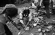 WOMEN SORT THROUGH SCRAP METAL PRIOR TO IT BEING MELTED. SINTESTI, ROMANIA, EASTER 1995..©JEREMY SUTTON-HIBBERT 2000..TEL./FAX. +44-141-649-2912..TEL. +44-7831-138817.