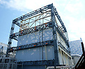 September 9, 2011, Okumamachi, Japan - Steel girders are in place in the construction of frames at the heavily damaged building of reactor Unit 1 of Fukushima No. 1 nuclear power plant in Okumamachi, Fukushima Prefecture, some 210km northeast of Tokyo, on Friday, September 9, 2011. Tokyo Electric Power Co., the troubled plant operator known as TEPCO, has started the project in covering up the No. 1 reactor building with polyester sheets in a bid to prevent the dispersal of radioactive substances into the air. The roughly one-millimeter-thick sheets will be attached to the steel frames of the 54-meter-high building. To minimize workers' exposure to radiation, the 140-meter-tall crane designed to ward off radiation will set up 62 pre-assembled parts at the reactor in the operation TEPCO hopes to be completed by September. (Photo by TEPCO/AFLO) [0006] -mis-