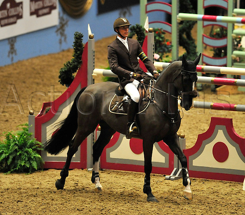 16.12.2010. Kevin Staut on Trappist of France in the Earls Court Christmas Cracker. The London International Horse Show Grand Hall Olympia London, England.