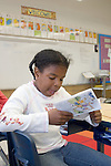 Oakland CA 2nd grader reading independently in class