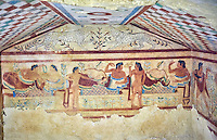 "Underground Etruscan tomb Known as ""Tomb of the Leopard A single chamber with double sloping ceiling decorated with a painted chequered design. In the tympanuim are painted two leopards below which is a banquet sceneOn the back wall is painted a banquet scene in honour of the dead. Circa 470 BC. Excavated 1857, Etruscan Necropolis of Monterozzi, Monte del Calvario, Tarquinia, Italy. A UNESCO World Heritage Site."
