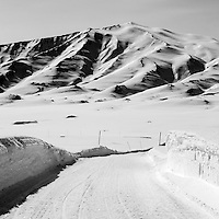 A snowy road near Mestersvig. Mestersvig is a military outpost with a runaway in the Scoresby Land region of the Northeast Greenland National Park. Originally built in anticipation of mining in the area it has been run by the Danish defence department since 1988. The place is staffed by two men whose duties include maintenance of buildings and the airfield and support of other activities in the area.