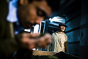Factory worker Tarun Sarki (right) looks on as his factory manager, Sanjay Mukherjee is seen inhaling the aroma of the first flush tea leaves after its drying process at Makaibari Tea Estate factory, Kurseong in Darjeeling, India.
