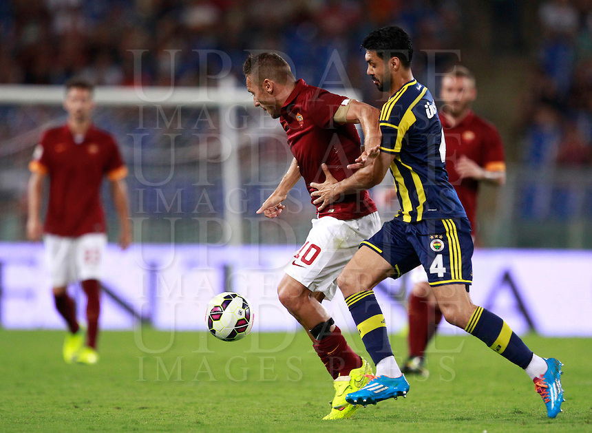 Calcio, amichevole Roma vs Fenerbahce. Roma, stadio Olimpico, 19 agosto 2014.<br /> Roma forward Francesco Totti is challenged by Fenerbache midfielder Bekir Irtegun, right, during the friendly match between AS Roma and Fenerbahce at Rome's Olympic stadium, 19 August 2014.<br /> UPDATE IMAGES PRESS/Isabella Bonotto