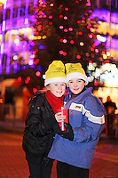 """NO REPRO FEE. 17/12/2010. Focus Ireland festive lights. Kate Conway 11 from Glasnevin and Max O Neill 9 from Rathgar with the Piccolo Lasso Choir are pictured on Grafton Street, Dublin as Pamela Flood switched on the lights on the Christmas Tree this evening for the Focus Ireland """"Sponsor a Star"""" campaign. EUR250,000 has been raised by businesses sponsoring a star on the landmark tree which is dedicated to people who are homeless. Picture James Horan/Collins Photos"""