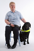Blind woman with her guide dog. MR