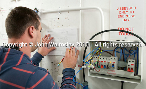 Student electrician writing up essential records, Able Skills, Dartford, Kent.