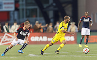 Foxborough, Massachusetts - July 26, 2014: First half action. In a Major League Soccer (MLS) match, the New England Revolution (blue/white) vs Columbus Crew (yellow), 0-1 (halftime), at Gillette Stadium.