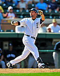 11 March 2009: Detroit Tigers' infielder Michael Hollimon loses his grip on the bat as it sails into the backstop netting during a Spring Training game against the New York Yankees at Joker Marchant Stadium in Lakeland, Florida. The Tigers defeated the Yankees 7-4 in the Grapefruit League matchup. Mandatory Photo Credit: Ed Wolfstein Photo