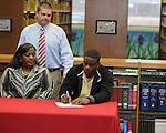 Lafayette High's Demarkous Dennis (5) signs a National Letter of Intent to play football at Itawamba Community College in Oxford, Miss. on Wednesday, February 1, 2012.