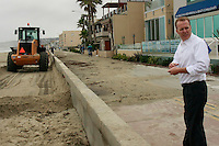 San Diego Councilmember for District 2, Kevin Faulconer watches from the boardwalk as Parks & Recreation machinery clears sand from the sea wall in Mission Beach, December 6  2007.  Faulconer was on hand to see the clean-up effort after heavy surf and high tides caused flooding in parts of Mission Beach earlier in the week.  With another storm front approaching, an operation to remove sand that had piled up against the seawall was underway.