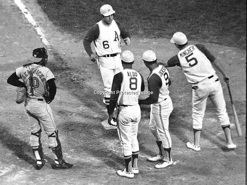 Oakland A's 3rd baseman captain Sal Bando with a Grand-Slam Home Run against the Baltimore for a 4 to 1 win. Greeted at home by Alou, Jackson and Don Mincher.(June3,1970 photo/Ron Riesterer)