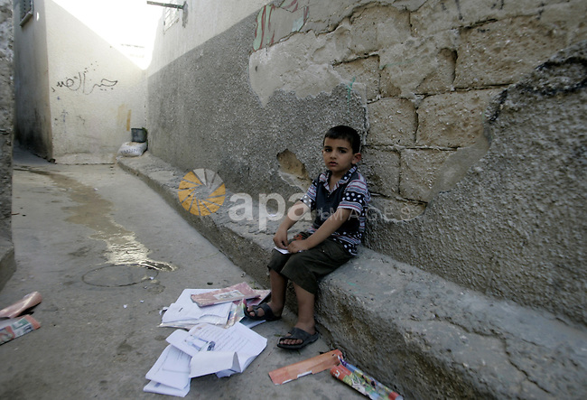 A Palestinian child sits in the street in the Rafah refugee camp in southern Gaza Strip on May 5, 2010. Palestinians mark the 15 of May every year as Nakba day, or the creation of the state of Israel in May 1948, that led many Palestinians to flee out of their homes. Photo by Abed Rahim Khatib