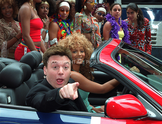 "Mike Myers and Beyonce Knowles participate in the taping for MTV's popular show, ""Total Request Live"" in Times Square, New York. They arrive at MTV Studios in ""Shaguar,"" a British flag-painted Jaguar which was featured in ""Goldmember."" July 26, 2002. Please byline: Alecsey Boldeskul/NY Photo Press.   ..*PAY-PER-USE*      ....NY Photo Press:  ..phone (646) 267-6913;   ..e-mail: info@nyphotopress.com"