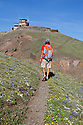 WY00595-00...WYOMING - Hiker on the approach to Mount Washburn in Yellowstone National Park.