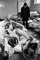 A man looks for a missing friend or relative among newly arrived corpses in the besieged Bosnian capital Sarajevo morgue on December 15, 1992.
