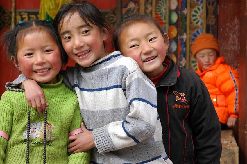 Tibetan kids in front of the Bakong Monastery, Dege - taken Mrch 20, 2008 - Michael Benanav - 505-579-4046