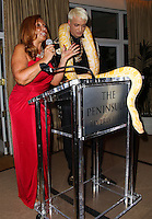 BEVERLY HILLS, CA, USA - MARCH 28: Tina Trozzo, KUBA Ka at the Versace Unveiling Of The 1st Pop Recording Artist Superhero - KUBA Ka's Performance Outfits. Designed by the legendary fashion hosuse - Donatella Versace. For the Benefit of the Face Forward Foundation (Plastic Surgery for Destroyed Faces from Violence). Pop entertainer TV personality KUBA Ka, together with VERSACE, unveiled Kuba Ka's new Versace images, for the First Pop Artist/Superhero of the World. He has become the inspiration of Donatella's newest and wildest creations and will celebrate the launch of his new power house conglomerate - KUBA Ka Empire Inc. in collaboration with the sensational fashion house - VERSACE on Friday, his birthday at a red carpet media and celebrity event at the luxurious Peninsula Hotel in Beverly Hills held at the Peninsula Hotel on March 28, 2014 in Beverly Hills, California, United States. (Photo by Xavier Collin/Celebrity Monitor)