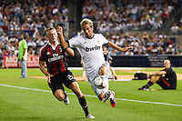 Fabio Coentra?o (15) of Real Madrid is marked by Ignazio Abate (20) of A. C. Milan. Real Madrid defeated A. C. Milan 5-1 during a 2012 Herbalife World Football Challenge match at Yankee Stadium in New York, NY, on August 8, 2012.