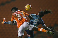 Blackpool's Armand Gnanduillet and Wycombe Wanderers' Marcus Bean fight for the ball in the air<br /> <br /> Photographer Alex Dodd/CameraSport<br /> <br /> Checkatrade Trophy Round 3 Blackpool v Wycombe Wanderers - Tuesday 10th January 2017 - Bloomfield Road - Blackpool<br />  <br /> World Copyright &copy; 2017 CameraSport. All rights reserved. 43 Linden Ave. Countesthorpe. Leicester. England. LE8 5PG - Tel: +44 (0) 116 277 4147 - admin@camerasport.com - www.camerasport.com