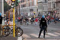Roma  15 Ottobre 2011.Manifestazione contro la crisi e l'austerità.Scontri tra manifestanti e forze dell'ordine.Manifestanti lanciano pietre contro  le forze dell'ordine in piazzale Appio