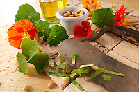 Naturtium leaves & flowers being prepared for a salad