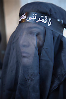 A woman pictured during the religious celebration of Tasooa (Tasua), on the 9th day of Muharram. Iranian women do not usually cover their faces with  the veil except during religious ceremonies.