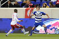 Heath Pearce (4) of FC Dallas is marked by Jeremy Hall (17) of the New York Red Bulls. The New York Red Bulls defeated FC Dallas 2-1 during a Major League Soccer (MLS) match at Red Bull Arena in Harrison, NJ, on April 17, 2010.