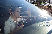 An irritated angry female driving a vehicle is expressing her road rage at Austin's eternally clogged roadways.