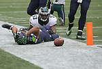 Seattle Seahawks Wide receiver Tyler Lockett (16) grabs his helmet after being taken out of bounds by  Philadelphia Eagles linebacker Nigel Bradham (53) after catching a 30-yard pass from Russell Wilson at CenturyLink Field in Seattle, Washington on November 20, 2016.  Seahawks beat the Eagles 26-15.    ©2016. Jim Bryant Photo. All Rights Reserved.