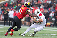 College Park, MD - October 1, 2016: Maryland Terrapins defensive lineman Jesse Aniebonam (41) sacks Purdue Boilermakers quarterback David Blough (11) during game between Purdue and Maryland at  Capital One Field at Maryland Stadium in College Park, MD.  (Photo by Elliott Brown/Media Images International)