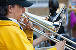 Esther Mayorga plays the trombone during The Terrible Adult Chamber Orchestra's (TACO) August 2 performance on the State Street Green.
