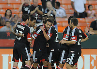 D.C. United forward Dwayne De Rosario (7) celebrates with teammates his score in the 19th minute of the game. D.C. United defeated The Chicago Fire 4-2 at RFK Stadium, Wednesday August 22, 2012.