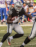 Oakland Raiders running back Latavius Murray (28) finds room to run on Sunday, December 04, 2016, at O.co Coliseum in Oakland, California.  The Raiders defeated the Bills 38-24.