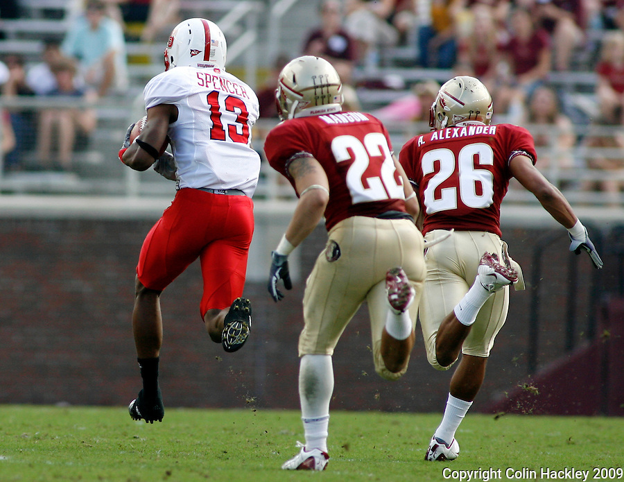 TALLAHASSEE, FL 10/31/09-FSU-NCST FB09 CH24-Florida State's Korey Mangum, left, and A.J. Alexander watch N.C. State's Owen Spencer disappear for an 80-yard touchdown   during first half action Saturday at Doak Campbell Stadium in Tallahassee. .COLIN HACKLEY PHOTO